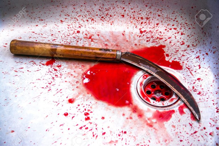 Sickle with blood at sink background,Kill concept,Murder concept